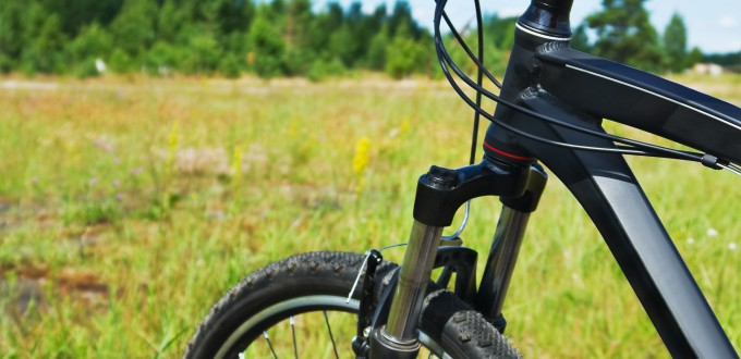 bike ride over rough terrain. Focus on the bicycle frame